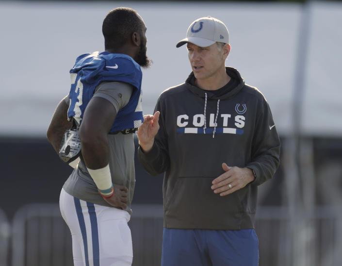 CORRECTS YEAR TO 2021 NOT 2020 - FILE - In this Aug. 6, 2018, file photo, Indianapolis Colts defensive coordinator Matt Eberflus, right, talks with linebacker Darius Leonard during practice at the NFL team's football training camp, in Westfield, Ind. The New York Jets' quickly growing list of head coaching candidates got a little longer Sunday, Jan. 10, 2021. Buffalo offensive coordinator Brian Daboll and Eberflus interviewed with New York a day after their teams squared off in a wild-card playoff game won by the Bills. (AP Photo/Michael Conroy, File)
