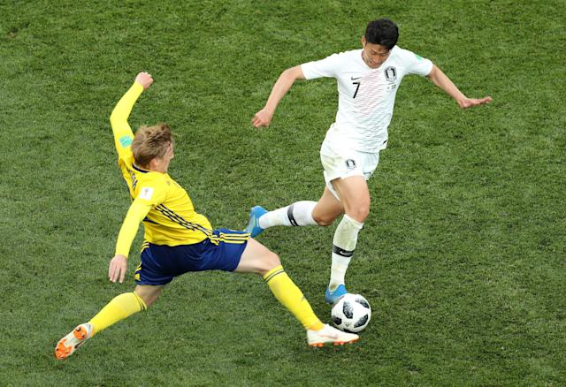 Soccer Football - World Cup - Group F - Sweden vs South Korea - Nizhny Novgorod Stadium, Nizhny Novgorod, Russia - June 18, 2018 Sweden's Emil Forsberg in action with South Korea's Son Heung-min REUTERS/Lucy Nicholson