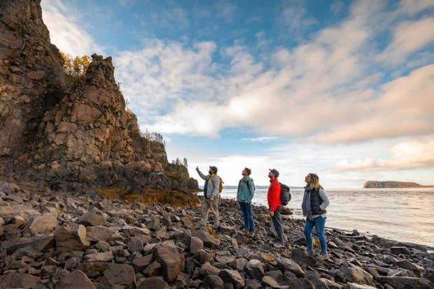 Brian Hebert (left) takes a group on a tour of the Bay of Fundy near Parrsboro, N.S.  (Tourism Nova Scotia - image credit)