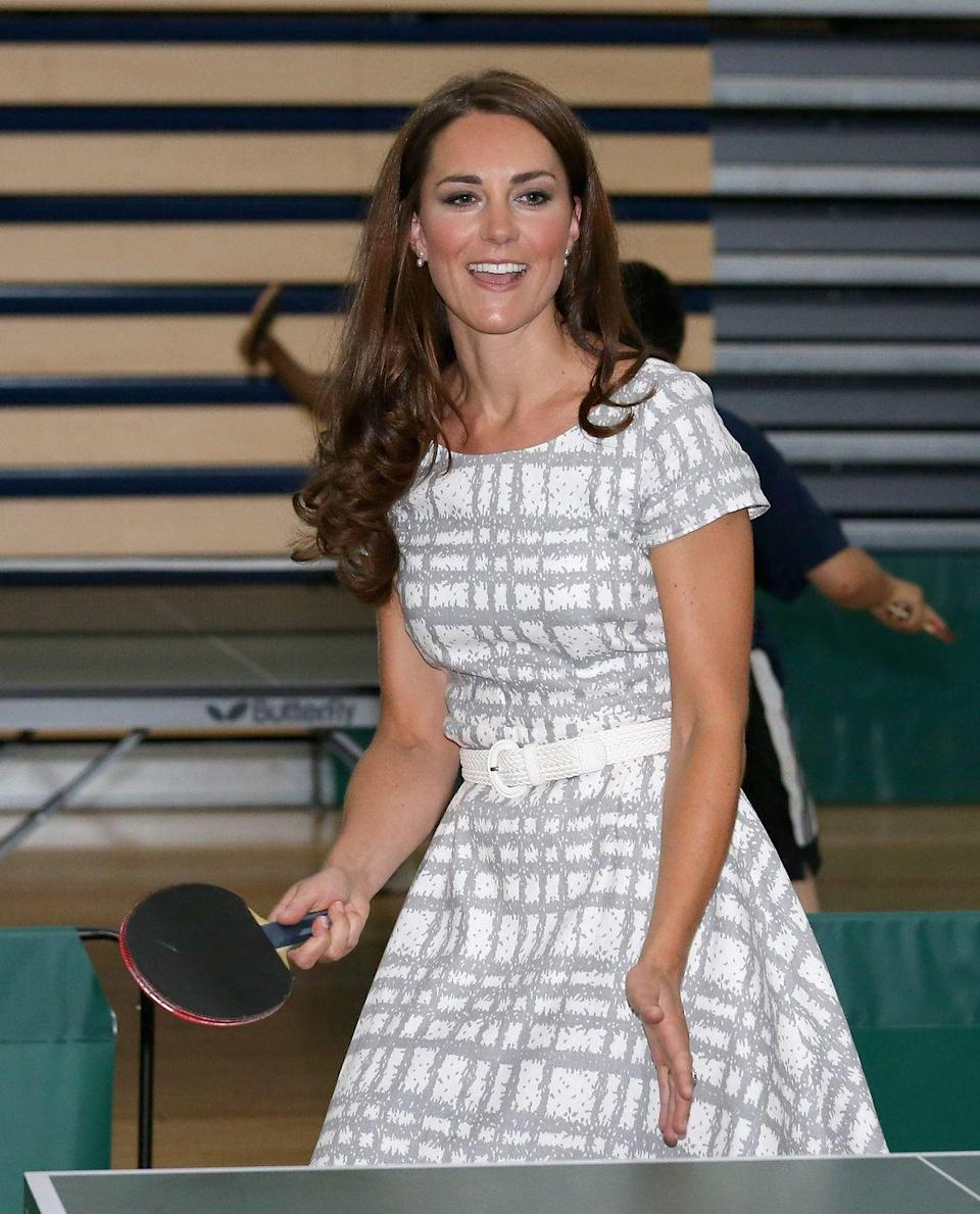 <p>And she also play table tennis! Kate wore a patterned gray and white dress from Hobbs for an event at Bacon's College in England. </p>
