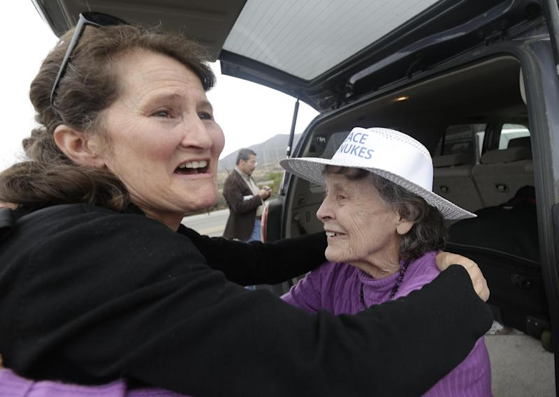 Lyn Harris Hicks, a longtime opponent of the San Onofre nuclear power plant and a nearby resident, right, hugs Laurie Headrick, left, as they wait for a news conference in front of the plant Friday, June 7, 2013, in San Onofre, Calif. The troubled power plant on the California coast is closing after an epic 16-month battle over whether the twin reactors could be safely restarted with millions of people living nearby, officials announced Friday. (AP Photo/Gregory Bull)