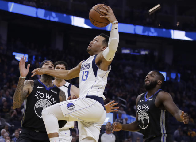 Dallas Mavericks' Jalen Brunson, right, shoots between Golden State Warriors' Willie Cauley-Stein, left, and Eric Paschall (7) during the first half of an NBA basketball game Tuesday, Jan. 14, 2020, in San Francisco. (AP Photo/Ben Margot)