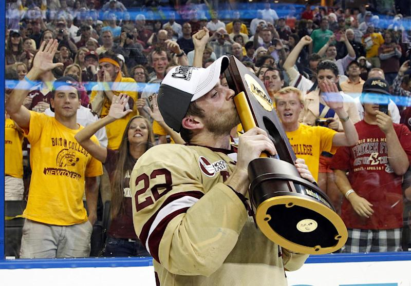 Boston College's Paul Carey kisses the National Championship trophy after the NCAA Frozen Four college hockey tournament final game against Ferris State Saturday, April 7, 2012, in Tampa, Fla. Boston College won 4-1 to claim the National Championship. (AP Photo/Mike Carlson)