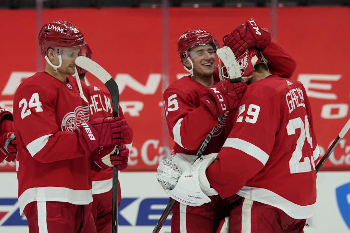 Detroit Red Wings goaltender Thomas Greiss (29) is greeted by forward Jakub Vrana (15) after the third period of an NHL hockey game against the Chicago Blackhawks, Thursday, April 15, 2021, in Detroit. (AP Photo/Carlos Osorio)