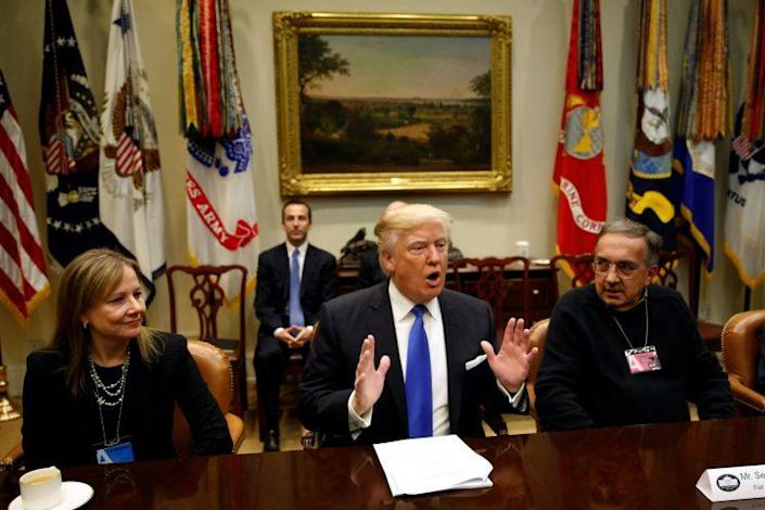 Flanked by General Motors CEO Mary Barra (L) and Fiat Chrysler CEO Sergio Marchionne (R), President Trump hosts a meeting with U.S. auto industry CEOs at the White House in January. (Photo: Kevin Lamarque/Reuters)