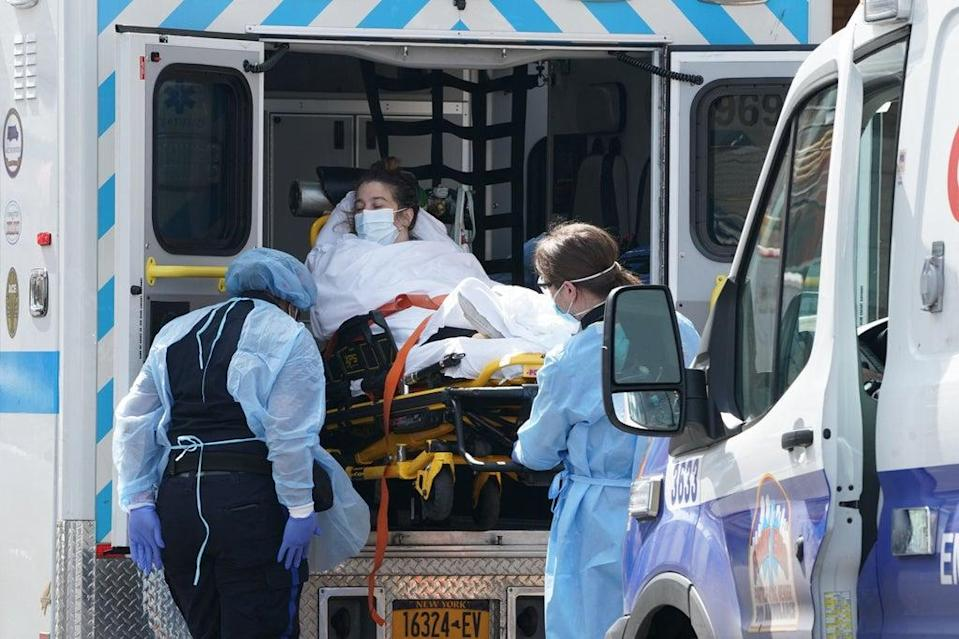 A woman arrives by ambulance to Wyckoff Hospital in the Bushwick section of Brooklyn (AFP via Getty Images)