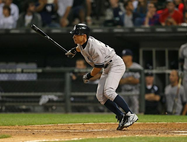 CHICAGO, IL - AUGUST 07: Ichiro Suzuki #31 of the New York Yankees singles in the 9th inning against the Chicago White Sox at U.S. Cellular Field on August 7, 2013 in Chicago, Illinois. The White Sox defeated the Yankees 6-5 in 12 innings. (Photo by Jonathan Daniel/Getty Images)