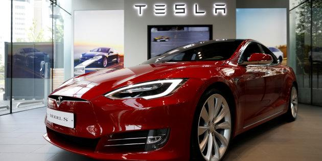 A Tesla Model S electric car at a dealership in Seoul, South Korea, July 6, 2017. Canada is well behind a majority of its developed-world peers when it comes to adopting electric car technology, a new report says.