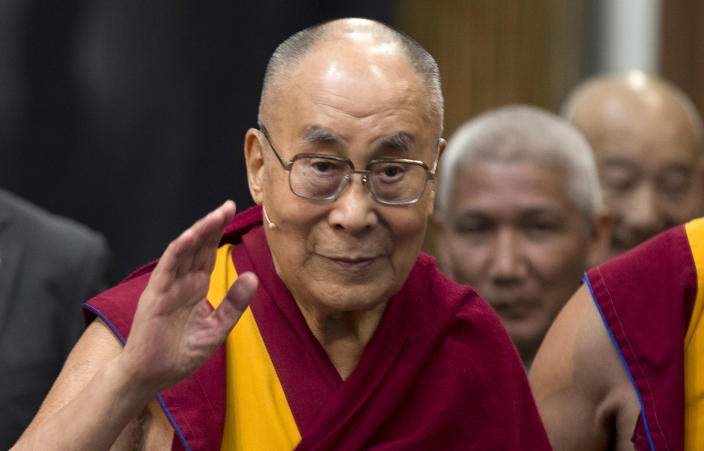 """FILE - In this Sept. 15, 2018, file photo, Tibetan spiritual leader the Dalai Lama greets journalists during the opening of the exhibition titled """"Buddha's Life"""" at the Nieuwe Kerk church in Amsterdam, Netherlands. The Dalai Lama has been hospitalised in the Indian capital with chest infection and is feeling much better. The Tibetan spiritual leader's spokesman Tenzin Taklha says the Dalai Lama is under medication and likely to spend a day or two in the hospital. The Dalai Lama flew to New Delhi from Dharmsala for consultations with doctors and was hospitaliszd on Tuesday, April 9, 2019. (AP Photo/Peter Dejong, File)"""