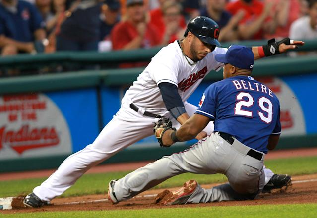 Texas Rangers' Adrian Beltre (29) tags out Cleveland Indians Mike Aviles at third base in the fourth inning of a baseball game Friday, Aug. 1, 2014, in Cleveland. (AP Photo/Aaron Josefczyk)