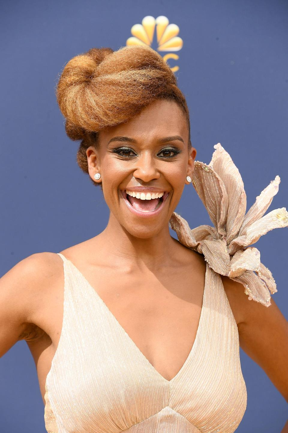 <p>Ryan Michelle Bathe's gorgeous braided pompadour is worthy of its own Emmy.</p>