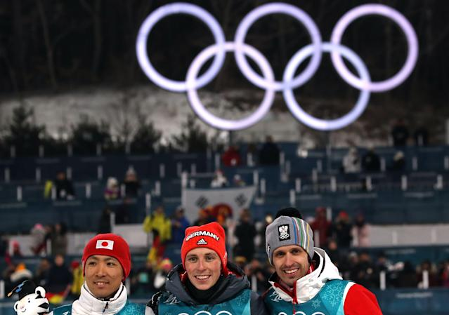 Nordic Combined Events – Pyeongchang 2018 Winter Olympics – Men's Individual 10km Final – Alpensia Cross-Country Skiing Centre - Pyeongchang, South Korea – February 14, 2018 - Gold medalist Eric Frenzel of Germany, silver medalist Akito Watabe of Japan and bronze medalist Lukas Klapfer of Austria celebrate during the victory ceremony. REUTERS/Carlos Barria