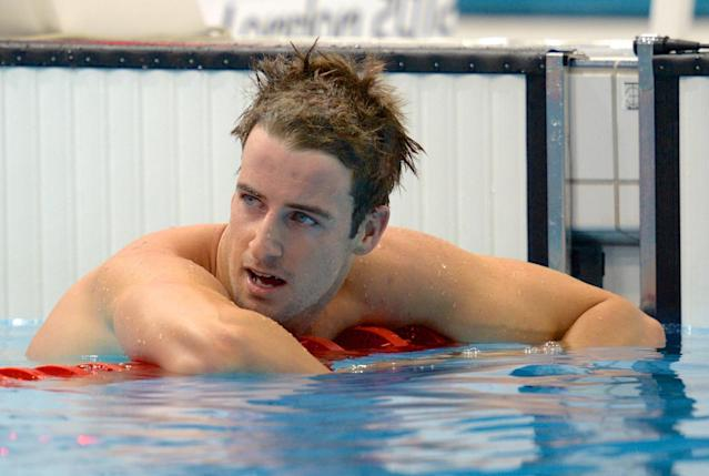 Australia's James Magnussen reacts after placing 2nd to take silver in the men's 100m freestyle final at the Aquatic Centre during the OLympic Games in London, Wednesday, Aug. 1, 2012. (AAP Image/Dean Lewins) NO ARCHIVING