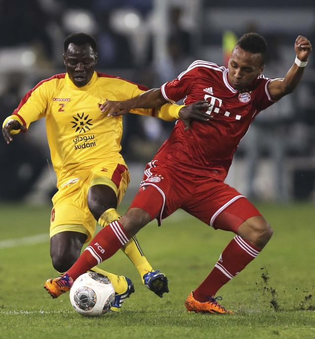 Bayern Munich's Julian Green fights for the ball with Al-Merrikh's Balla Jabir during their friendly soccer match in Doha