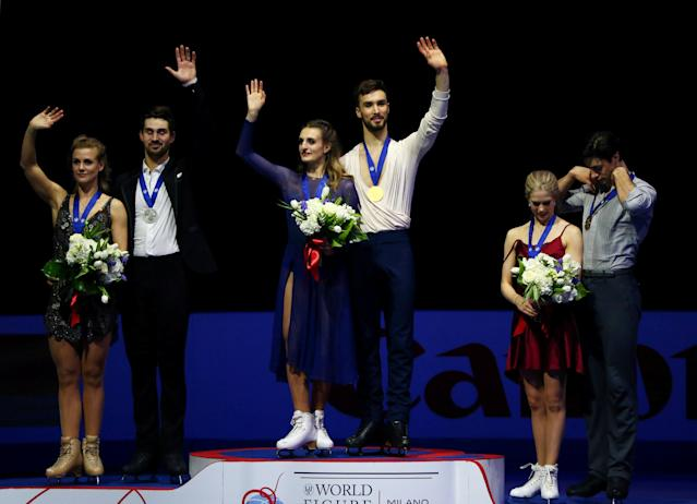 REFILE - CORRECTING IDS Figure Skating - World Figure Skating Championships - The Mediolanum Forum, Milan, Italy - March 24, 2018 - France's Gabriella Papadakis and Guillaume Cizeron pose after winning the gold medal in the Ice Dance with second placed Madison Hubbell and Zachary Donohue of the U.S. and third placed Canada's Kaitlyn Weaver and Andrew Poje. REUTERS/Alessandro Bianchi