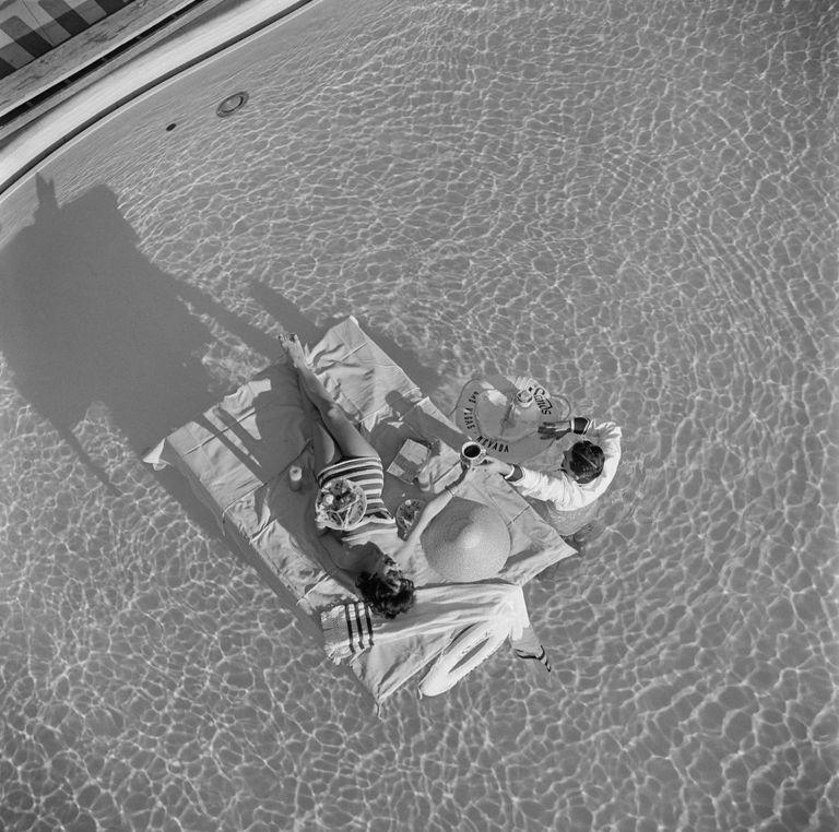 <p>Austrian actress Mara Lane getting waiter service in the Sands pool in 1954. Many celebrities visited Las Vegas to enjoy the high luxury accommodations offered at hotels in the area.</p>