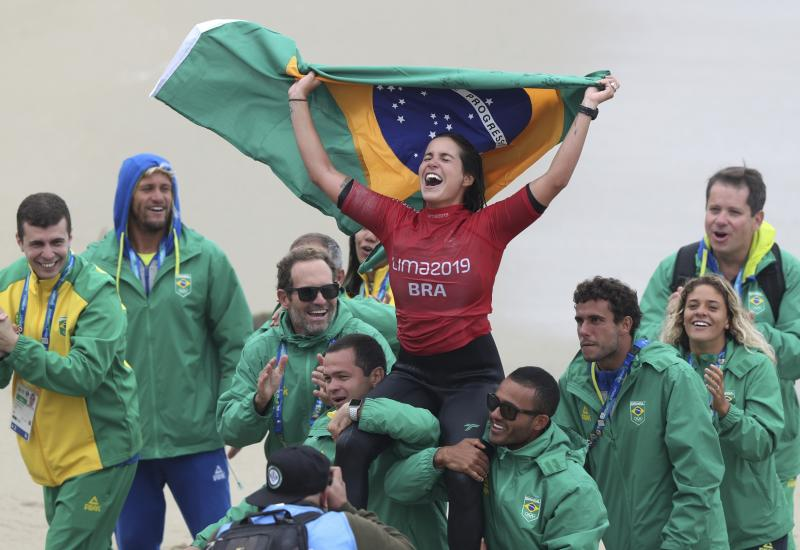 Chloe Calmon of Brazil celebrates wining the gold for longboard in the women's SUP surfing final at the Pan American Games on Punta Rocas beach in Lima Peru, Sunday, Aug. 4, 2019. (AP Photo/Martin Mejia)