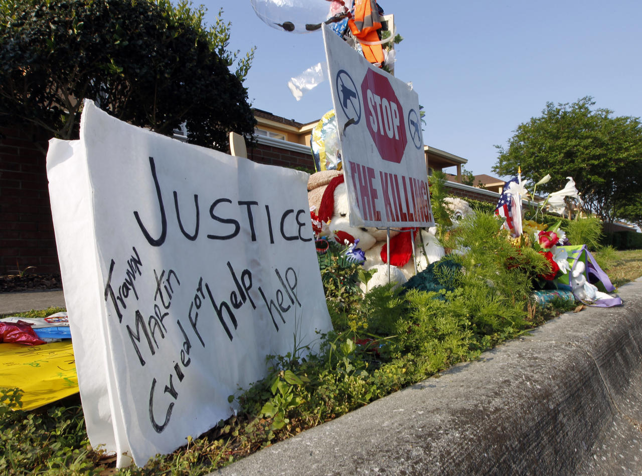A makeshift memorial for Trayvon Martin is displayed Thursday, April 12, 2012, on the sidewalk outside the complex where Martin was shot dead by neighborhood watch volunteer George Zimmerman in Sanford, Fla. Zimmerman has been charged with second-degree murder in the shooting death of the 17-year-old and is expected in court Thursday. (AP Photo/Chris O'Meara)