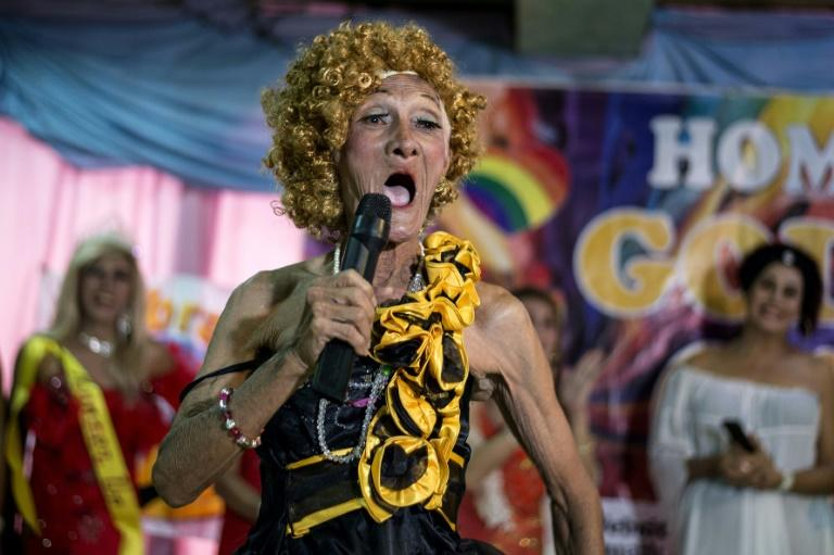 "Street vendor and Golden Gays member Al Enriquez, 82, also known as ""Carmen Dela Rue"", introduces himself to the crowd during the Golden Gays of Manila Beauty Pageant"