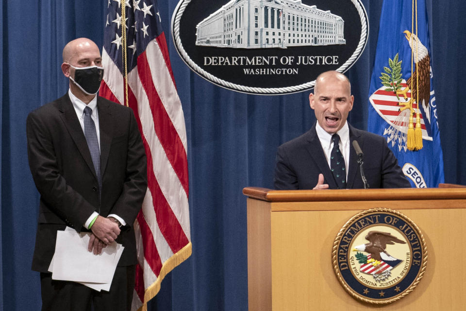 """Steven D'Antuono, head of the Federal Bureau of Investigation (FBI) Washington field office, left, listens as acting U.S. Attorney Michael Sherwin, speaks during a news conference Tuesday, Jan. 12, 2021, in Washington. Federal prosecutors are looking at bringing """"significant"""" cases involving possible sedition and conspiracy charges in last week's riot at the U.S. Capitol. (Sarah Silbiger/Pool via AP)"""