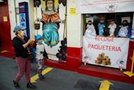 Despite a partial lockdown in Mexico City, customers still trickle into stores to buy the Covid-themed clothes for their dolls