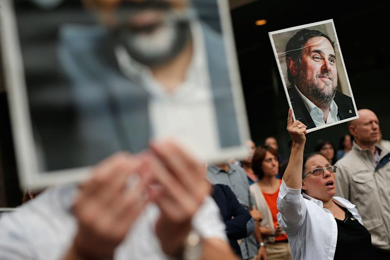 A woman holds a placard depecting a picture of jailed Catalan separatist leader Oriol Junqueras in Barcelona (AFP via Getty Images)