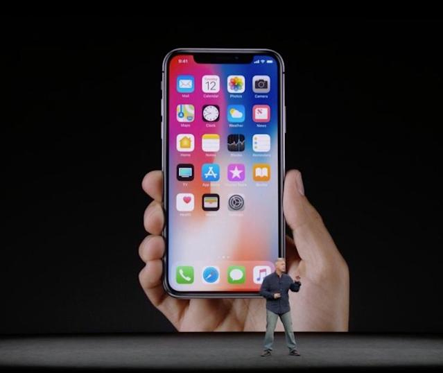 Apple's Phil Schiller debuts the iPhone X at the company's new headquarters in Cupertino, California.