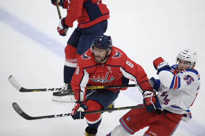 Washington Capitals left wing Alex Ovechkin (8) hits New York Rangers defenseman Ryan Lindgren (55) during the second period of an NHL hockey game, Sunday, March 28, 2021, in Washington. (AP Photo/Nick Wass)