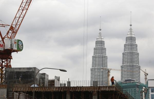 According to Rahim & Co, property transactions in Malaysia fell by 15.8 per cent and 21.6 per cent in volume and value compared to the same period in 2019. — Reuters pic