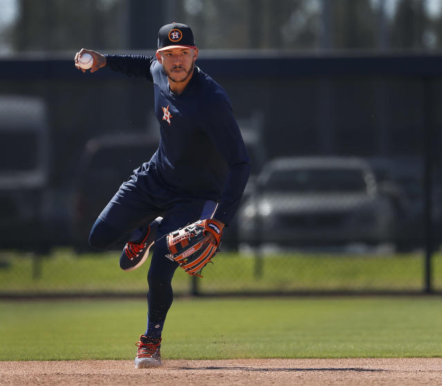 Houston Astros shortstop Carlos Correa throws the ball on a back field during spring baseball training, Friday, Feb. 16, 2018, in West Palm Beach, Fla. (Karen Warren/Houston Chronicle via AP)