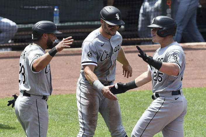 Chicago White Sox's Andrew Vaughn, right, is greeted by Adam Engel, center, and Leury Garcia after hitting a three-run home run against the Baltimore Orioles In the sixth inning of a baseball game, July 11, 2021, in Baltimore. All three scored on the hit. (AP Photo/Gail Burton)