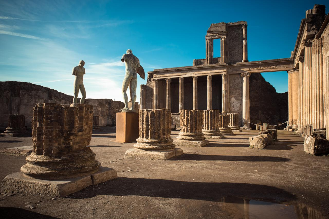 "Ruins of ancient city of Pompeii, which was destroyed by volcano, Mount Vesuvius, about two millenniums ago, 79 AD. Buildings are still very well preserved, a lot of walls still standing. The place is open for visitors and it's a popular destination for tourists in Italy.<em> </em><a href=""https://fave.co/2Pne4qd"">Book a visit here</a><em> [Photo: Getty]</em>"