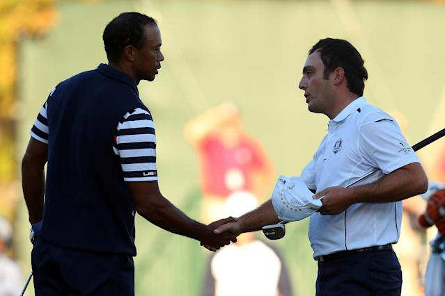 "<h1 class=""title"">Ryder Cup - Day Three Singles</h1> <div class=""caption""> MEDINAH, IL - SEPTEMBER 30: Francesco Molinari of Europe (R) shakes hands with Tiger Woods of the USA on the 18th green after halving his match with Woods during the Singles Matches for The 39th Ryder Cup at Medinah Country Club on September 30, 2012 in Medinah, Illinois. (Photo by Mike Ehrmann/Getty Images) </div> <cite class=""credit"">Mike Ehrmann</cite>"