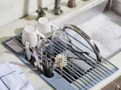 <p>The smart <span>Five Two Over-the-Sink Drying Rack</span> ($45) will save you space on your countertop.</p>