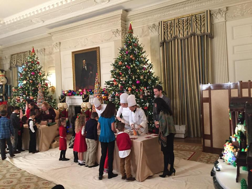 <p>Children of military families make holiday treats in the State Dining room with first lady Michelle Obama.<i> (Photo: Cassie Carothers)</i></p>