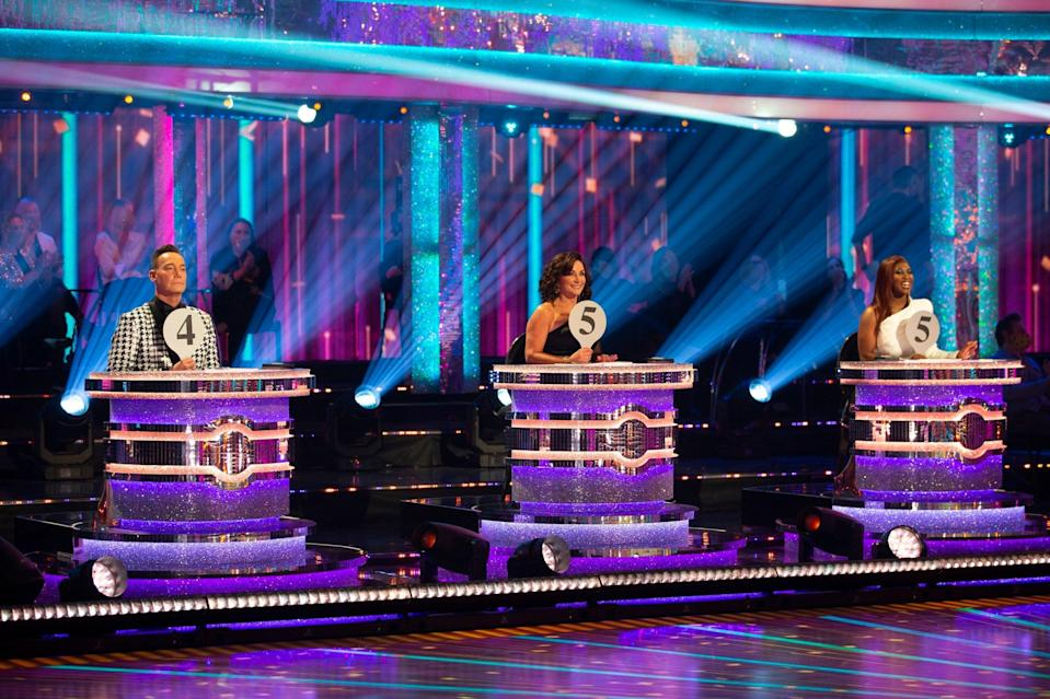 Judges Craig Revel Horwood, Shirley Ballas and Motsi Mabuse sat a distance from one another (PA)