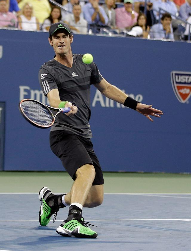 Andy Murray, of Britain, returns a shot to Novak Djokovic, of Serbia, during the quarterfinals of the U.S. Open tennis tournament Wednesday, Sept. 3, 2014, in New York. (AP Photo/Darron Cummings)
