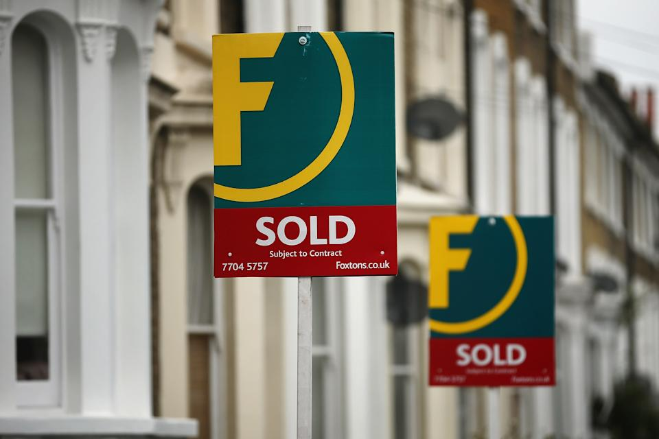 LONDON, ENGLAND - JUNE 11:  Foxtons estate agent signs advertise residential properties as 'Sold' in the Stockwell area on June 11, 2013 in London, England. The owners of the estate agency chain, BC Partners, have reportedly hired three banks; Credit Suisse, Canaccord Genuity, and Numis Securities, to work on a flotation on the London stock exchange that could value it at more than £400m.  (Photo by Dan Kitwood/Getty Images)