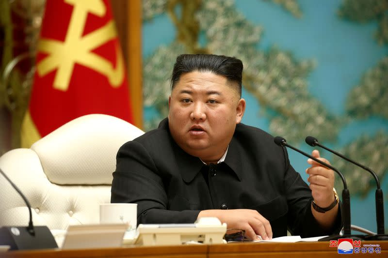 FILE PHOTO: North Korean leader Kim Jong Un speaks during the 19th Meeting of the Political Bureau of the 7th Central Committee of WPK