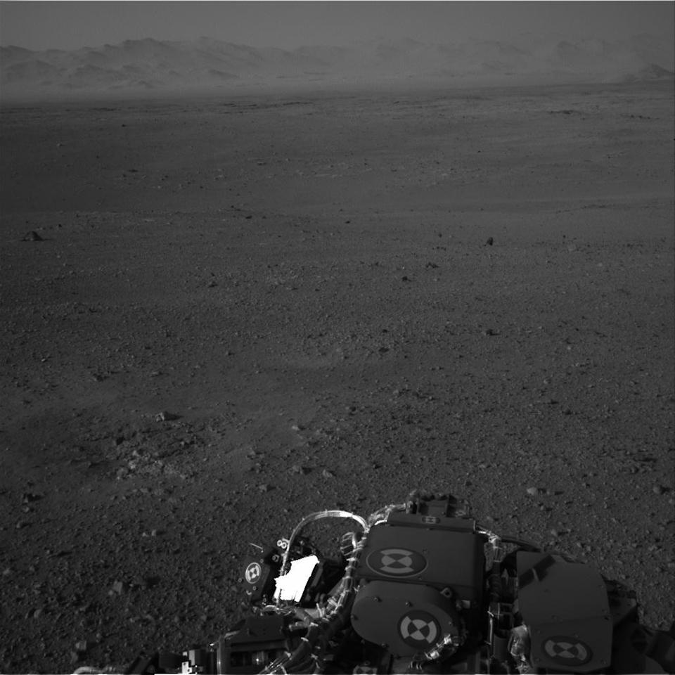 This image released by NASA on Wednesday Aug. 8, 2012 taken by cameras aboard the Curiosity rover shows the Martian horizon. It's one of dozens of images that will be made into a panorama. Curiosity landed on August 5, 2012 on a two-year mission to study whether its landing site ever could have supported microbial life. (AP Photo/NASA)