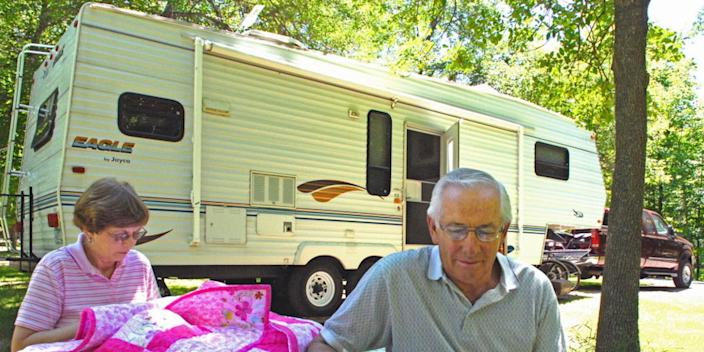 Marian and Frank Pladson of Glenwood, Minnesota sitting by their 32-foot fifth wheel trailer in 2007.