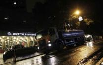 A worker drives a truck transporting potable water after distributing it to the Sirio Libanes Hospital, in Sao Paulo February 10, 2015. REUTERS/Nacho Doce