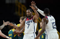 United States's Kevin Durant (7) celebrates with teammates after scoring during men's basketball semifinal game against Australia at the 2020 Summer Olympics, Thursday, Aug. 5, 2021, in Saitama, Japan. (AP Photo/Charlie Neibergall)