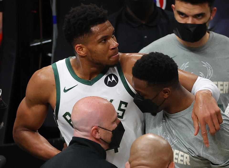 Giannis Antetokounmpo #34 of the Milwaukee Bucks is helped off the court after being injured on a play against the Atlanta Hawks during the second half in Game Four of the Eastern Conference Finals at State Farm Arena on June 29, 2021 in Atlanta, Georgia. NOTE TO USER: User expressly acknowledges and agrees that, by downloading and or using this photograph, User is consenting to the terms and conditions of the Getty Images License Agreement. (Photo by Kevin C. Cox/Getty Images)
