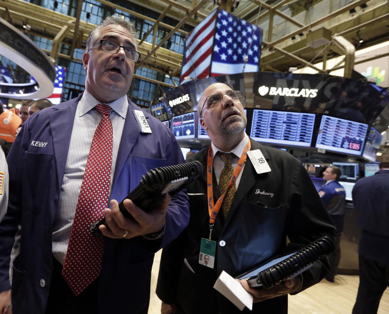 Stocks end a four-day advance as energy slides