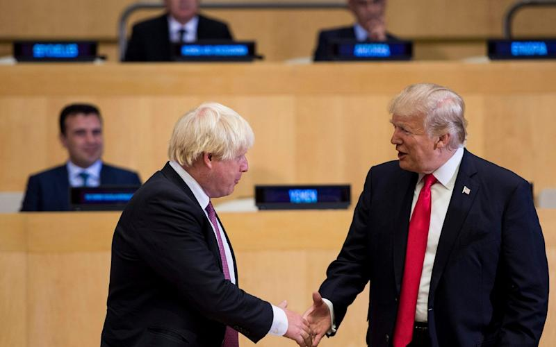Boris Johnson and US President Donald Trump greet before a meeting on United Nations Reform at UN headquarters in New York - AFP
