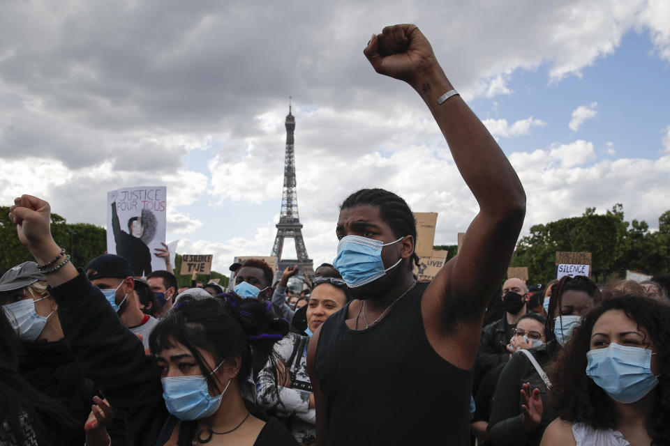 FILE - In this June 6, 2020, file photo, hundreds of demonstrators gather on the Champs de Mars as the Eiffel Tower is seen in the background during a demonstration in Paris to protest against the recent killing of George Floyd. As Minneapolis braces for Monday's opening statements in the trial of Derek Chauvin, the ex-officer who is charged with murder and manslaughter in George Floyd's death, so does the world. (AP Photo/Francois Mori, File)