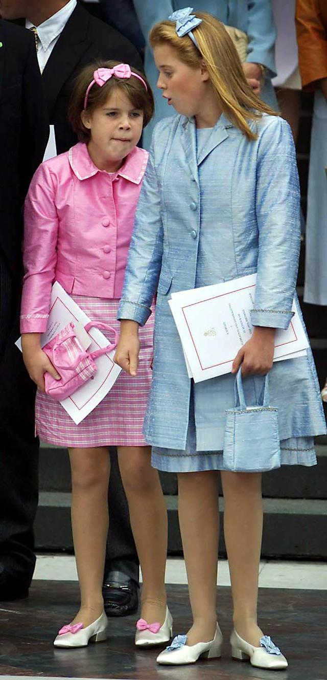 Princesses Eugenie (left) and Beatrice waiting for their car on the steps of St Paul's Cathedral in 2000. (Press Association)