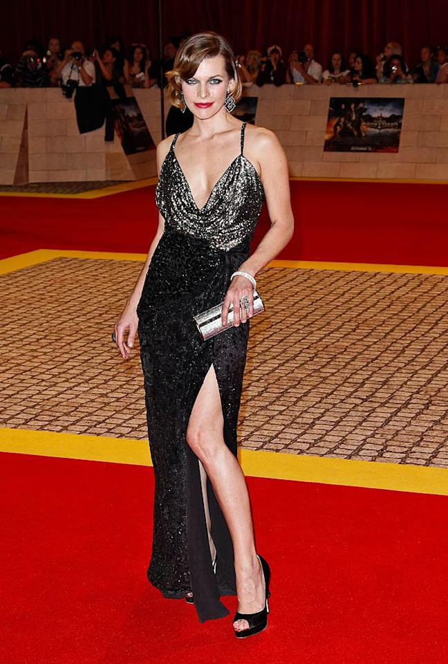 "Despite being in London for the world premiere of ""The Three Musketeers,"" Milla Jovovich channeled Old Hollywood glamour by pairing a sensational Salvatore Ferragamo gown with Brian Atwood peep-toes, a Jimmy Choo clutch, and Jacob & Co. jewels.  Splash News - October 4, 2011"