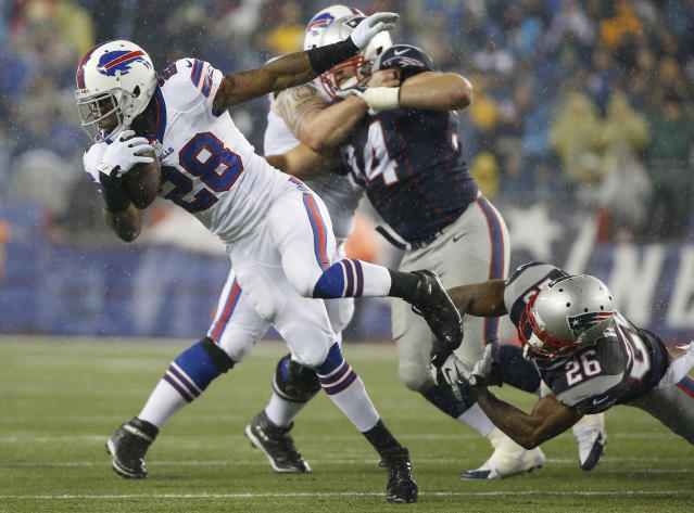 Buffalo Bills running back C.J. Spiller (28) slips free from New England Patriots defensive back Logan Ryan (26) in the second quarter of an NFL football game, Sunday, Dec. 29, 2013, in Foxborough, Mass. (AP Photo/Elise Amendola)